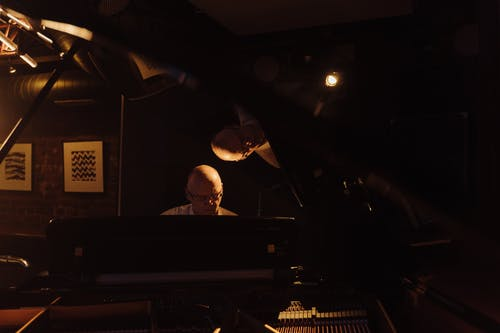 Man in Black Shirt Playing Piano