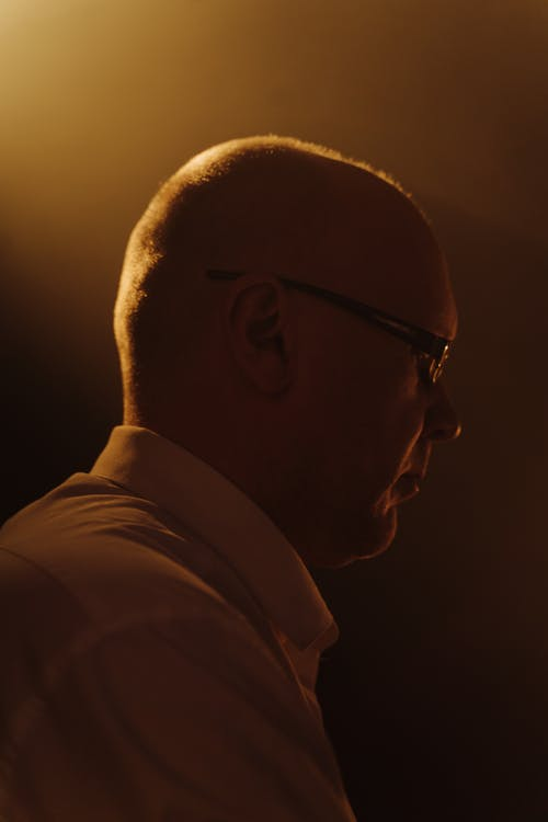 Man in White Collared Shirt Wearing Black Framed Eyeglasses