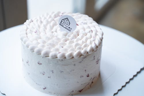 White and Pink Cake on White Ceramic Plate