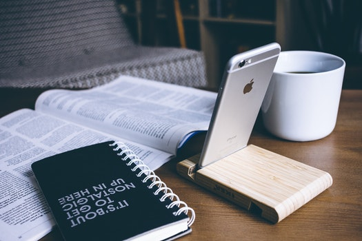 Book and Silver Iphone 6 on Top of Table