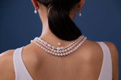 Woman Wearing White Pearl Necklace
