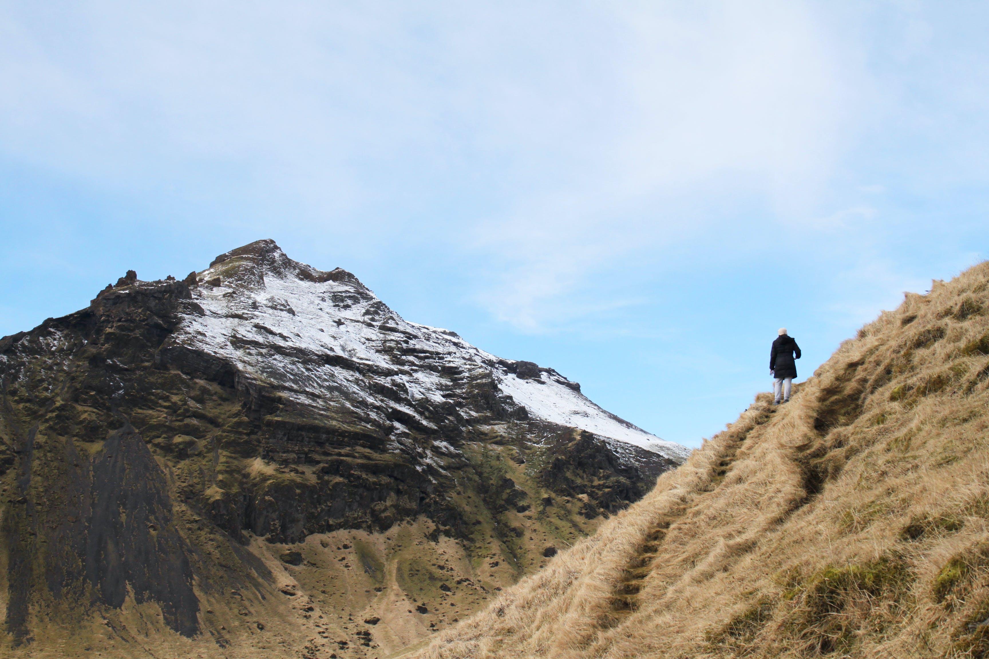 Person Climb on Mountain