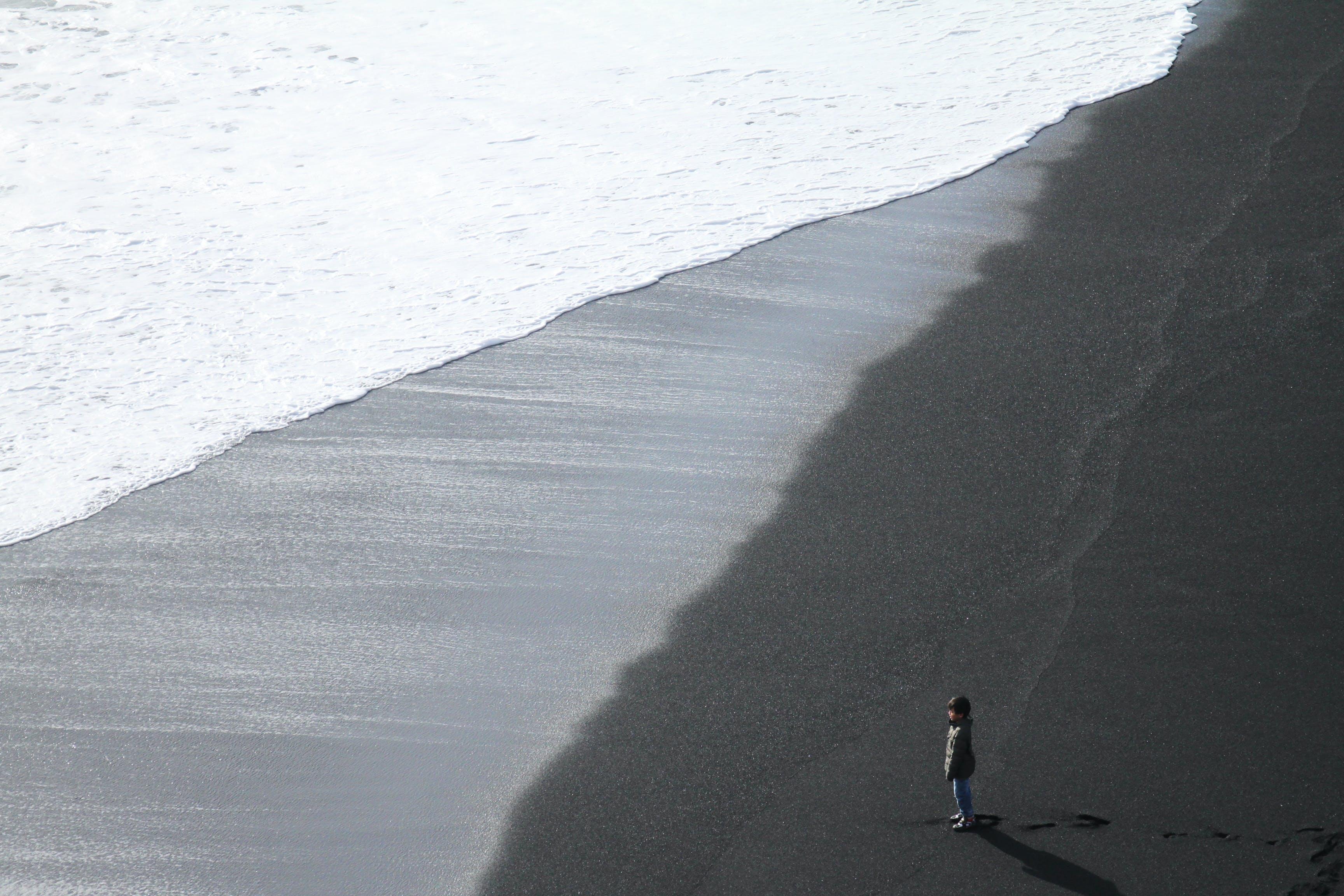 Child Standing on the Seashore