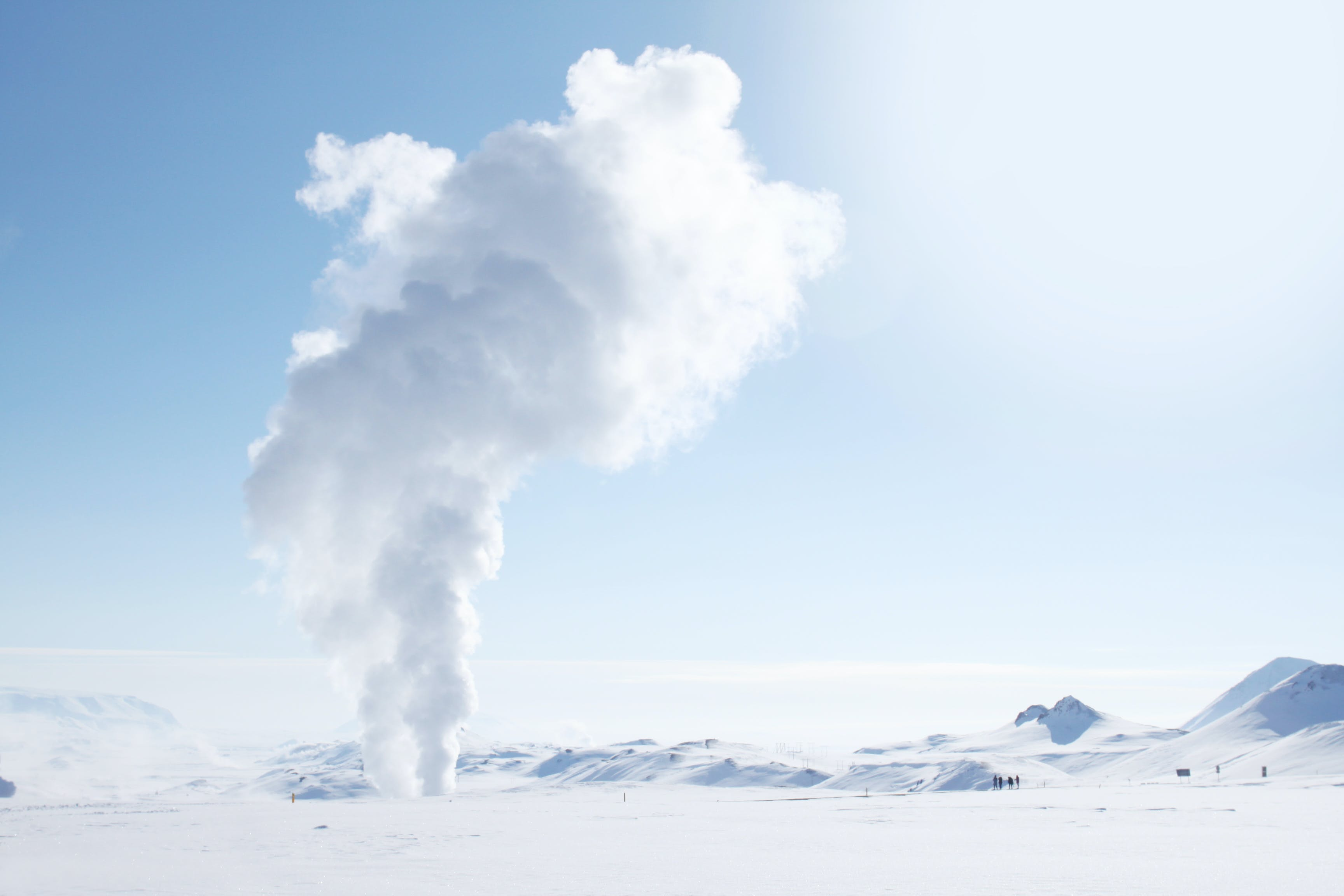 Smoke Rising from Snow-covered Field