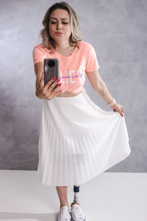 Woman in White Dress Holding Iphone
