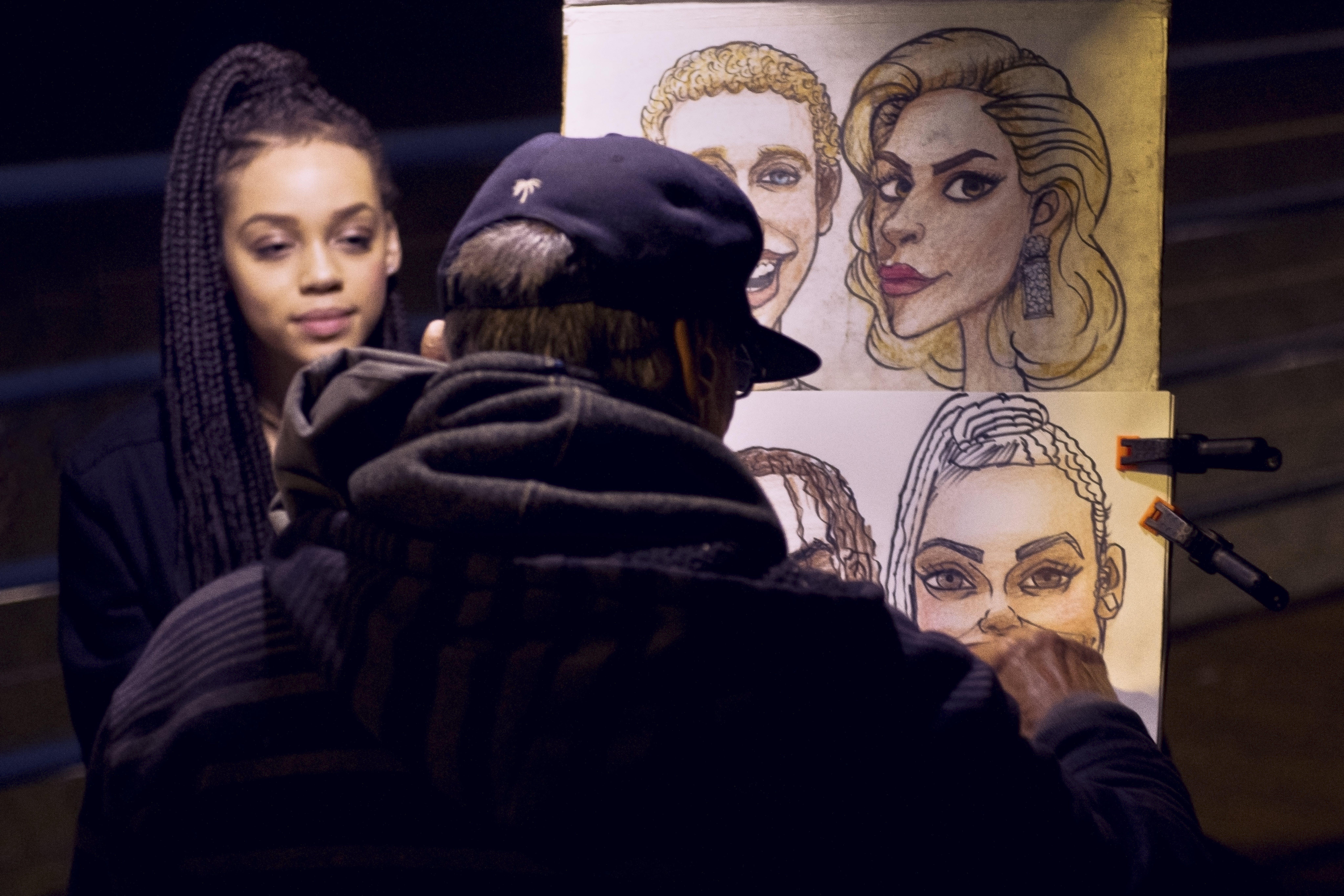 Person Wearing Hoodie Making Illustration