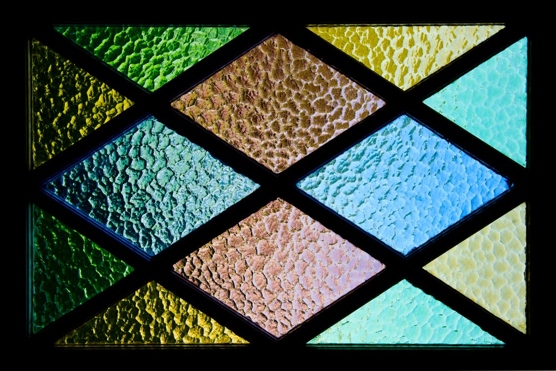 Green, Yellow, Brown, and Blue Stained Glass