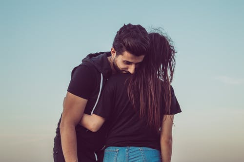 Man Leaning on Womans Shoulder