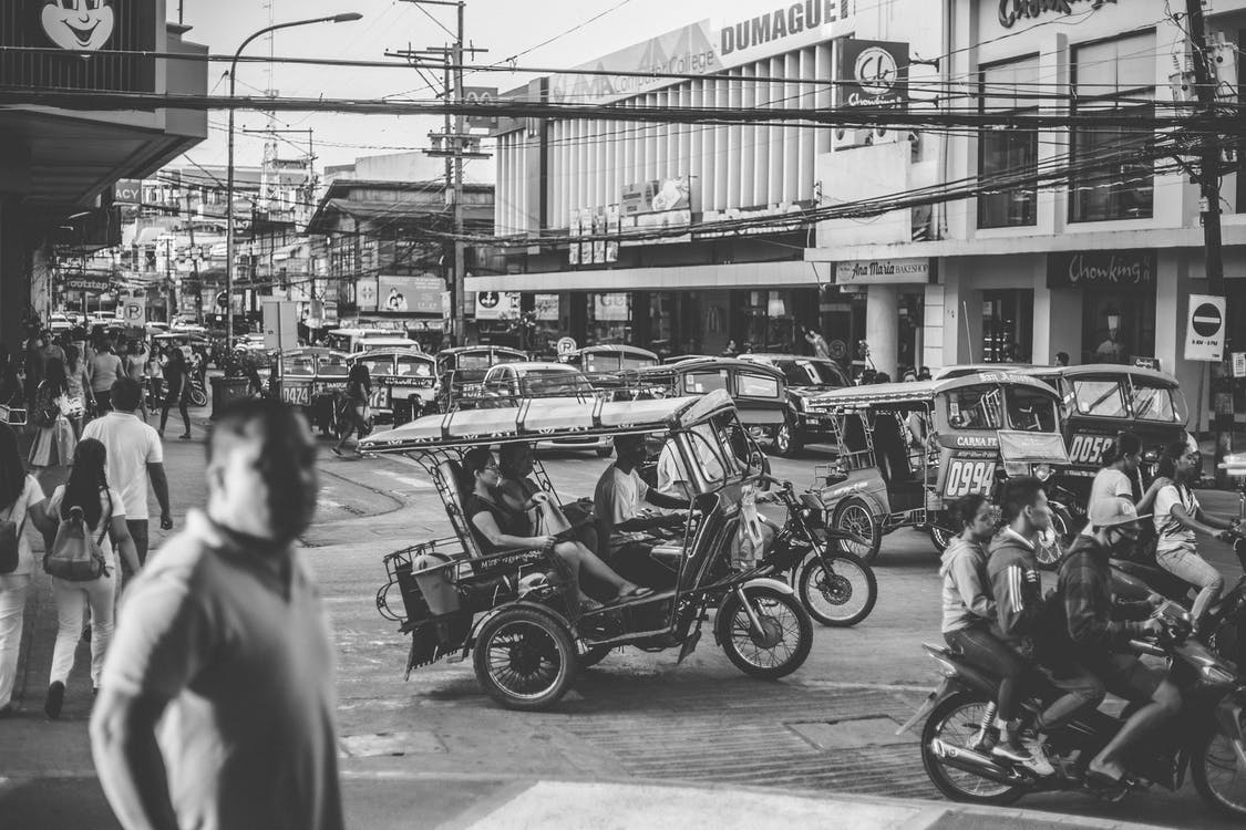 Grayscale Photo of Motorcycles and People