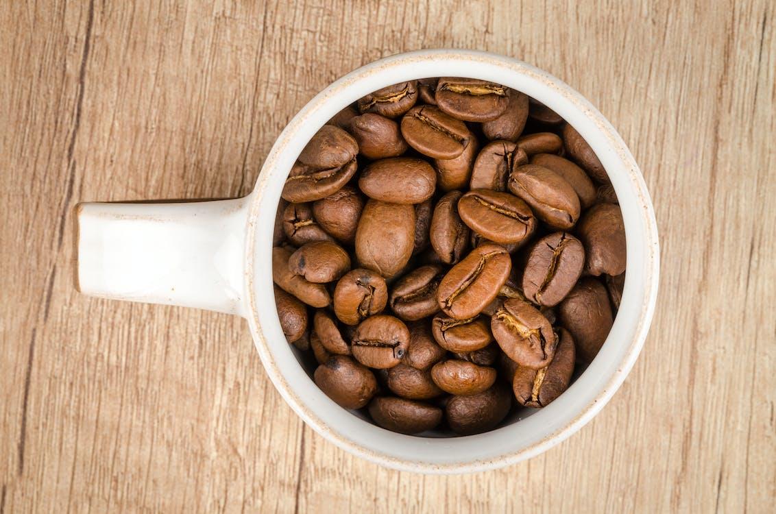 Roasted Coffee Beans Inside White Ceramic Mug