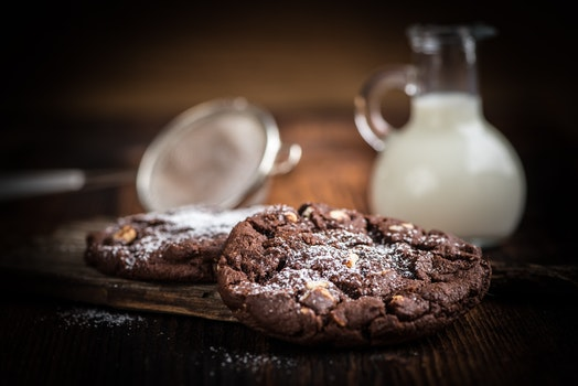 Brown Cookie Chips Near Clear Glass Jar With White Liquid