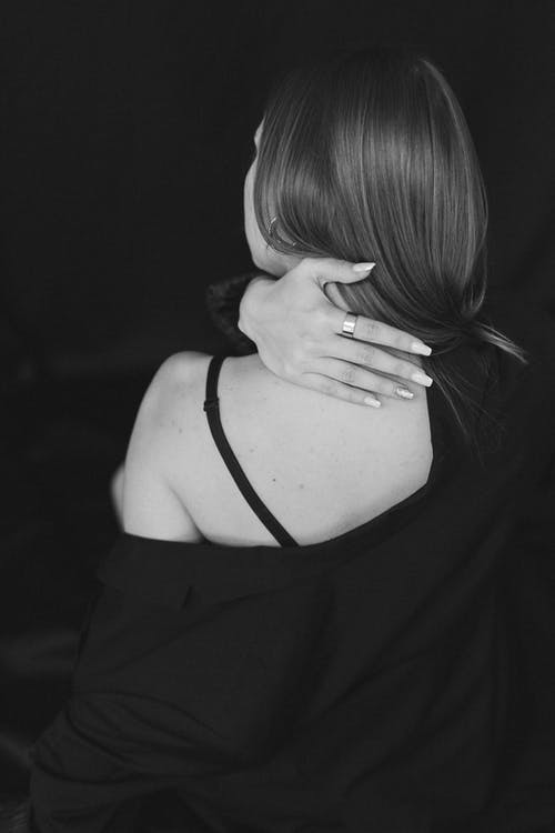 A Woman with Her Hand on Her Nape