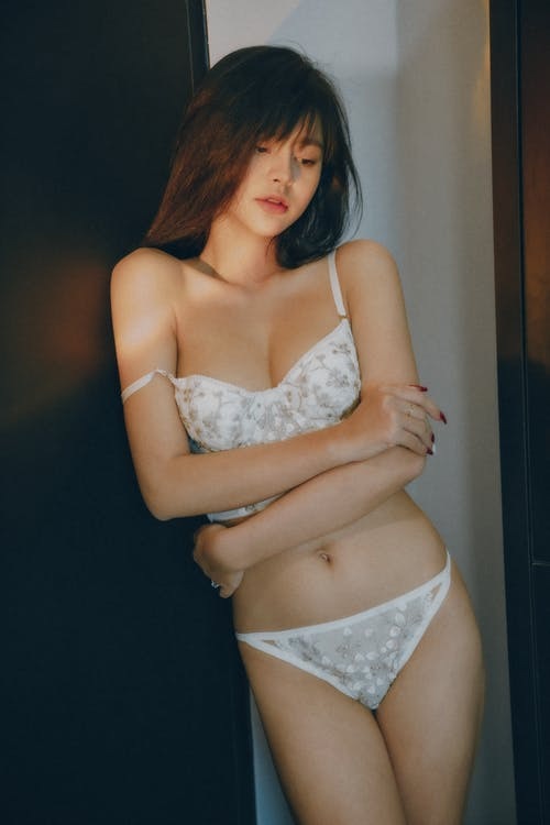 Woman in White Floral Brassiere and Panty