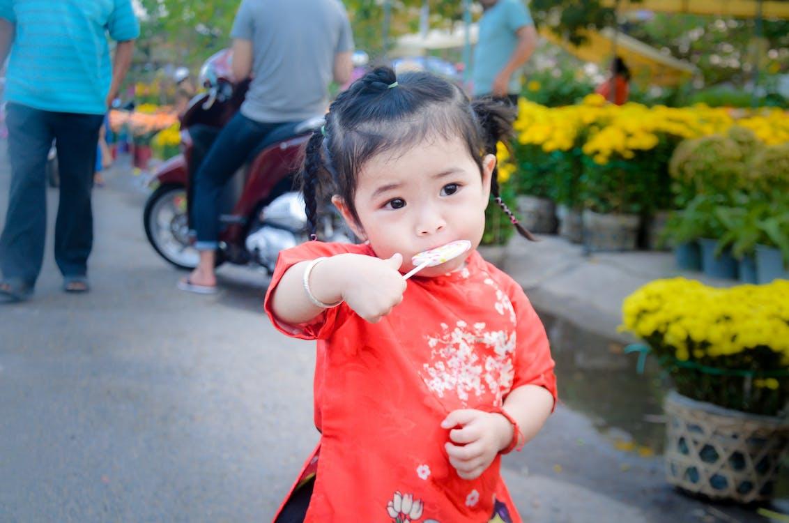 334dac70d9aa Girl Eating Lollipop · Free Stock Photo