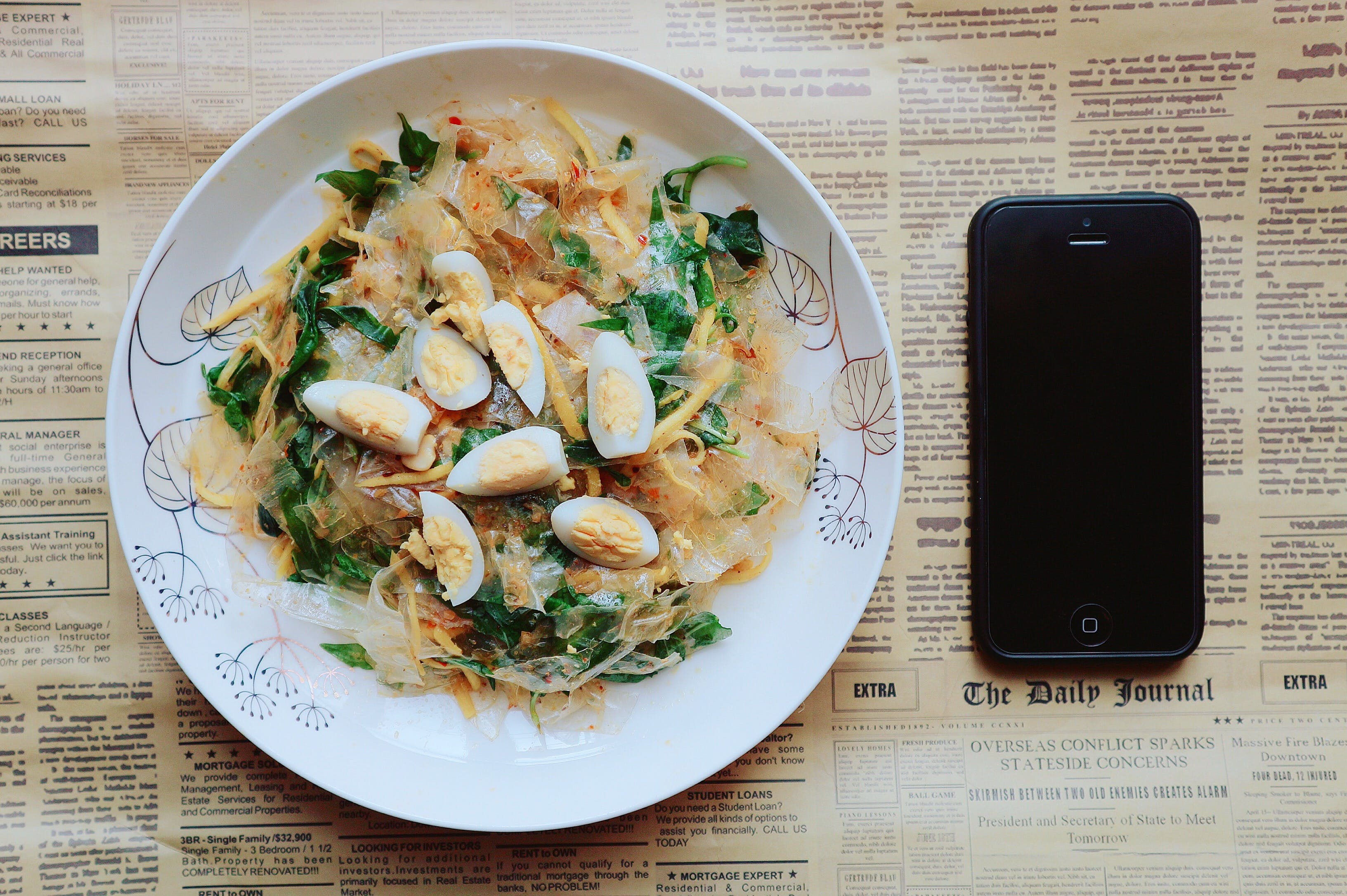 Black Iphone 5 Near Plate of Pasta Dish