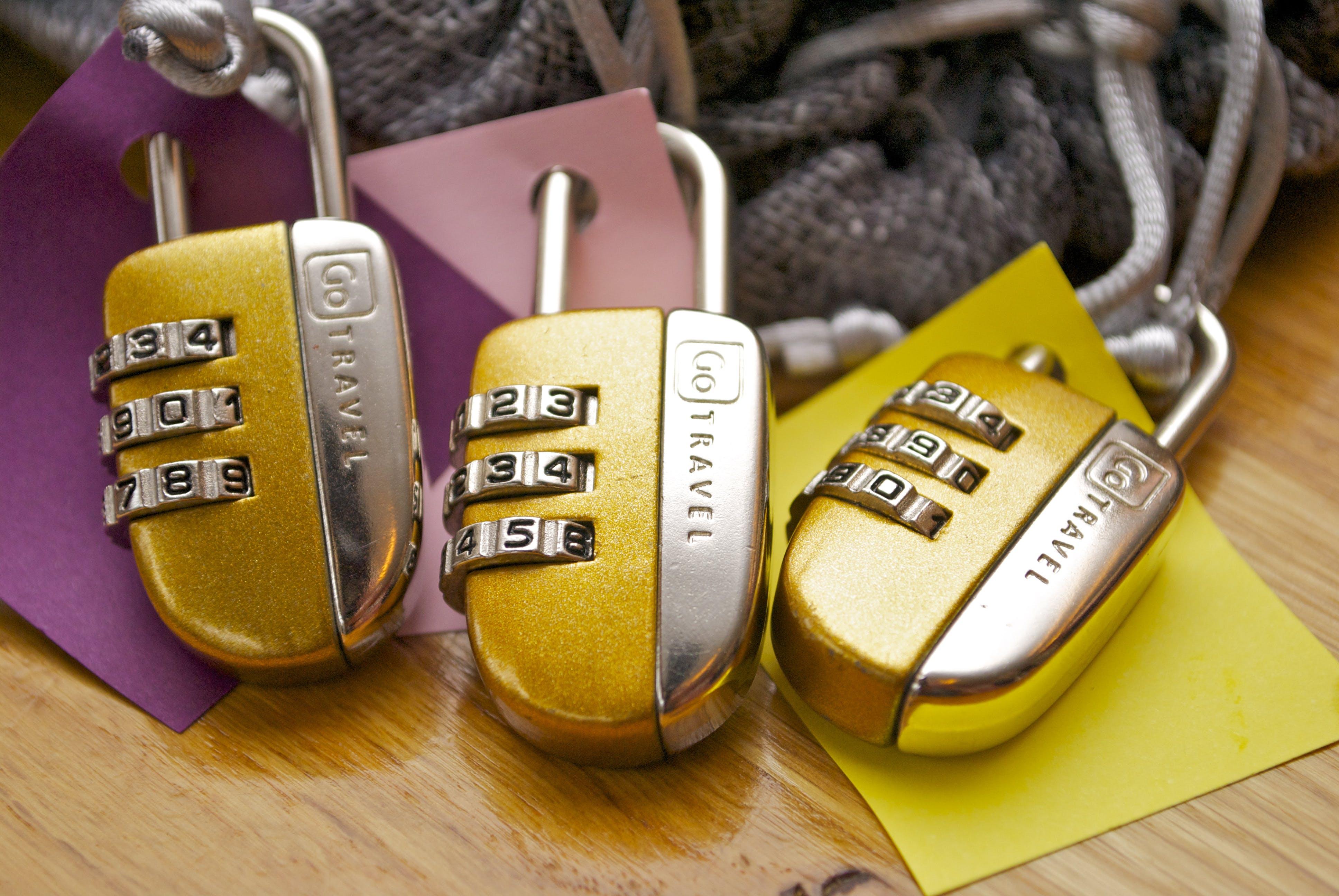 Three Gold-and-silver Combination Padlocks