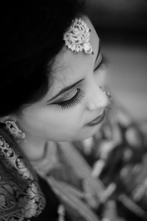 Grayscale Photo of Woman Wearing Indian Traditional Dress