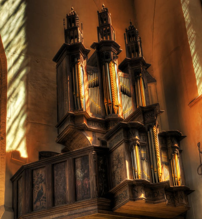 Brown and Beige Pipe Organ in Corner