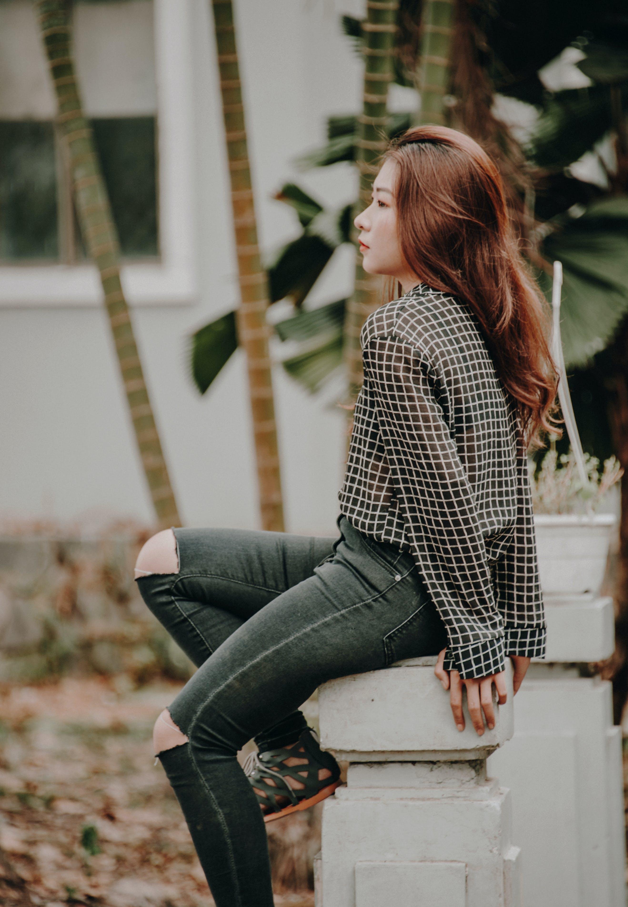 Woman Wearing Black and White Grid Chiffon Dress Shirt