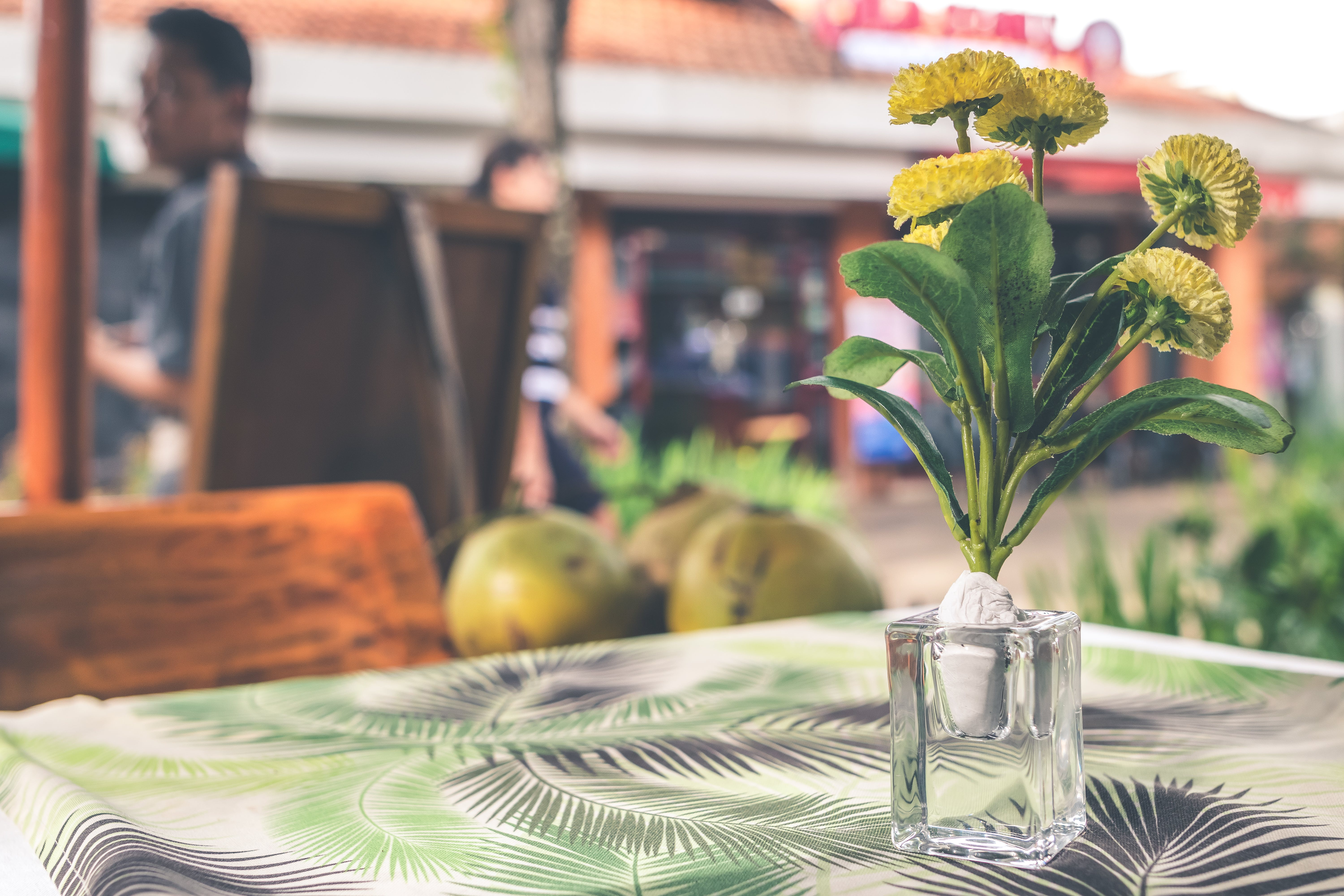 Yellow Flower Arrangement in Vase on Top of Table