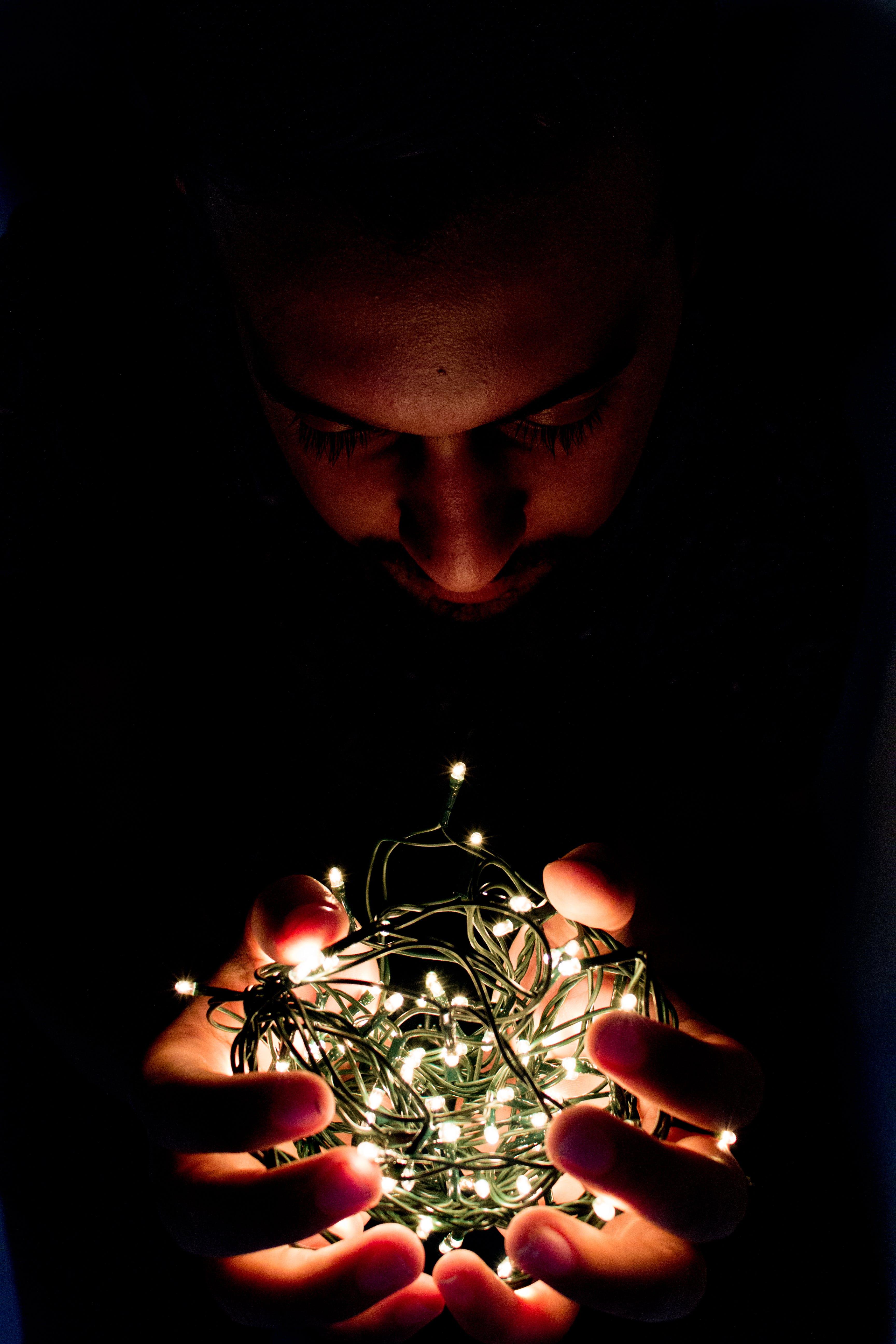 Man Holding String Light