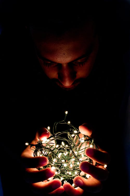 Man Holding String Light