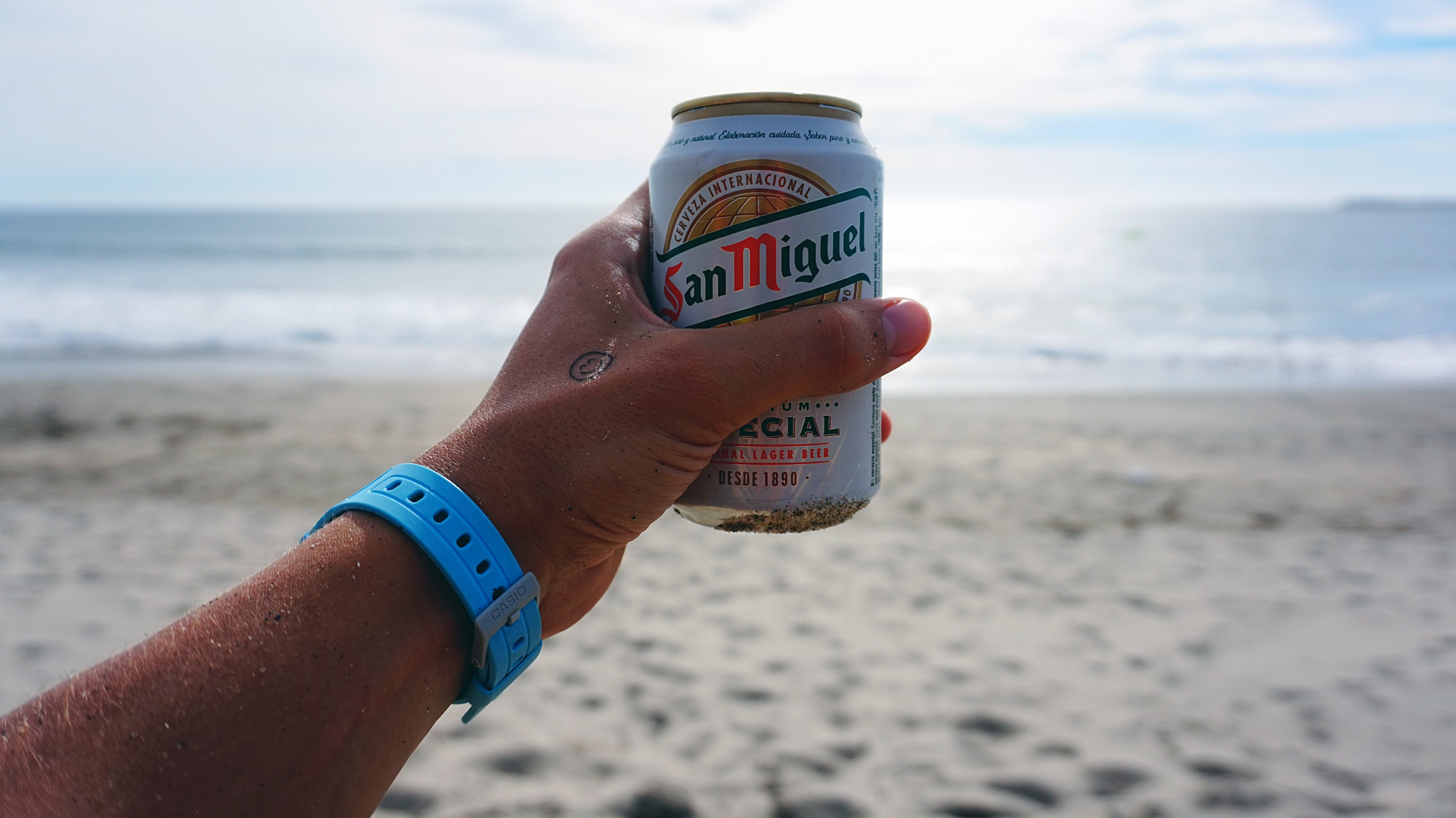 Person Holding San Miguel Beer Tin Can