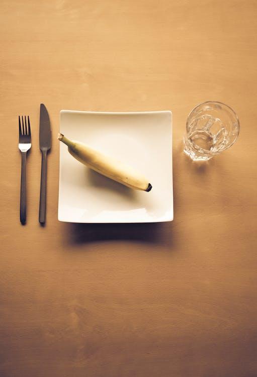 Yellow Banana on White Square Plate
