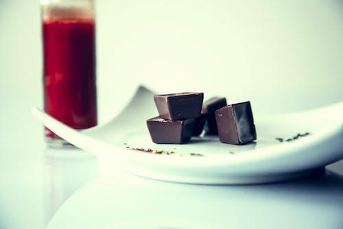 Kostnadsfri bild av choklad, dricksglas, sötsaker, tallrik