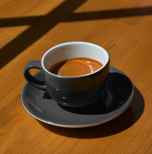 Black Ceramic Cup on Saucer