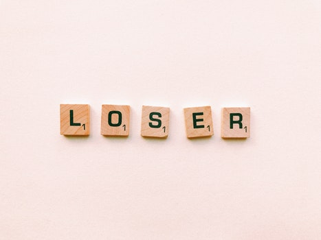 Closeup Photography of Loser Scrabble Letter