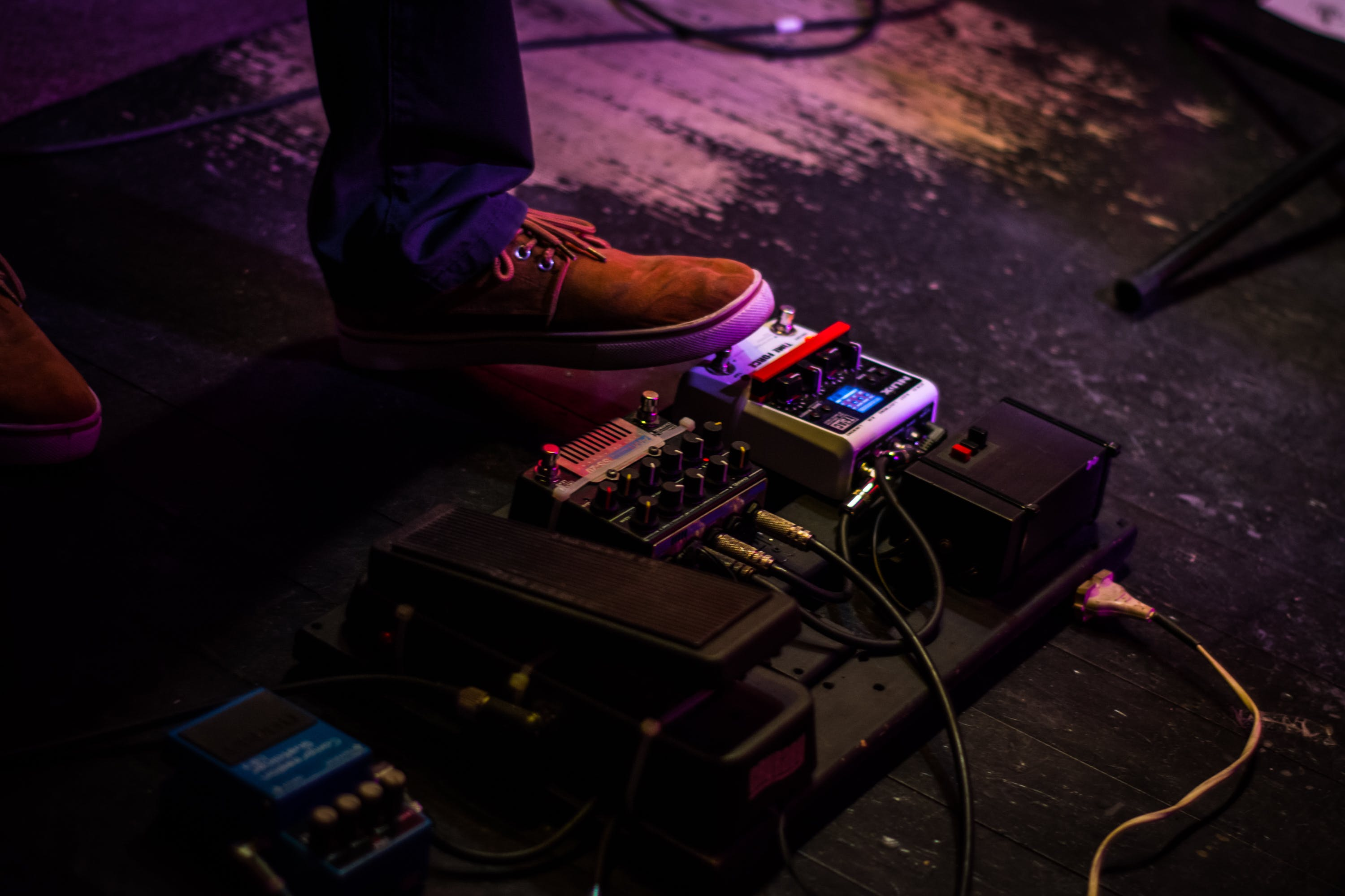 Person Operating Guitar Effects Pedal