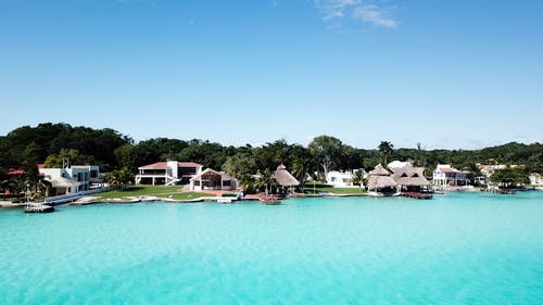 Foto profissional grátis de corretor, investir propriedades, lagoa azul