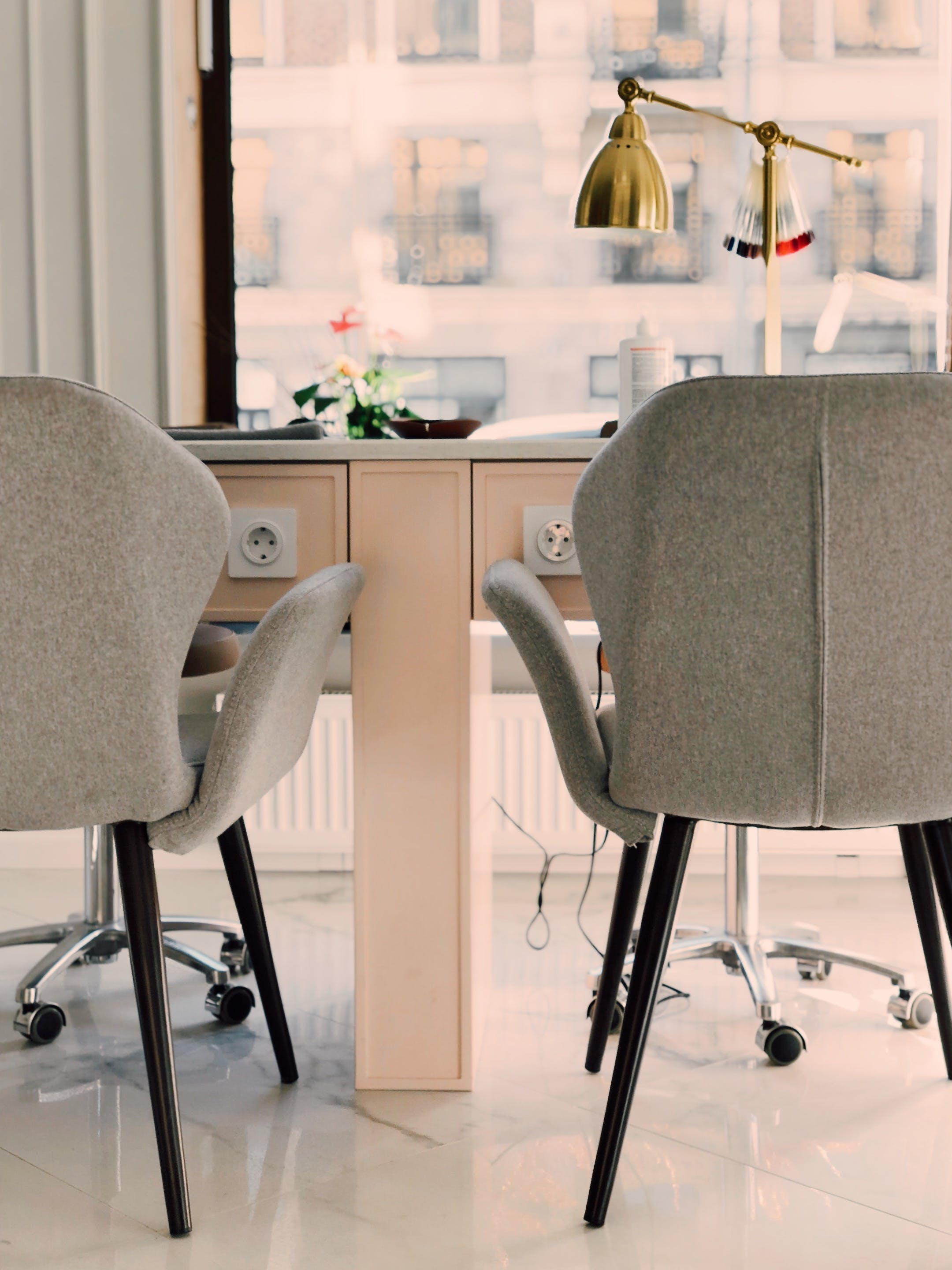 Gray Armchairs Beside White Wooden Desk
