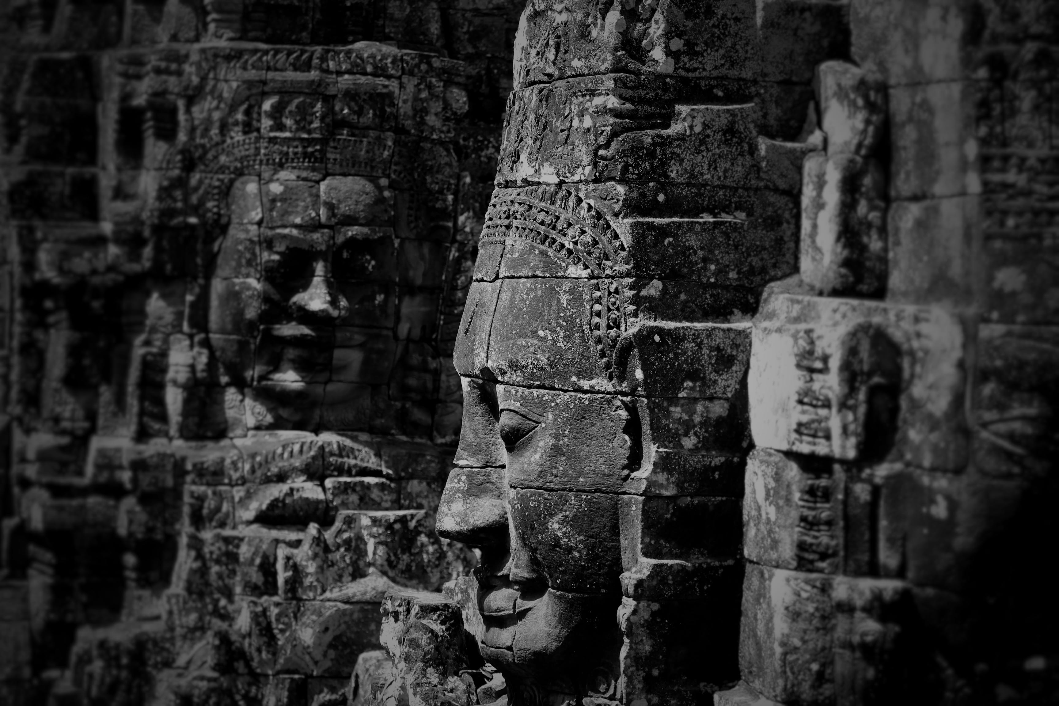 Grayscale Photo of Buddha Statues