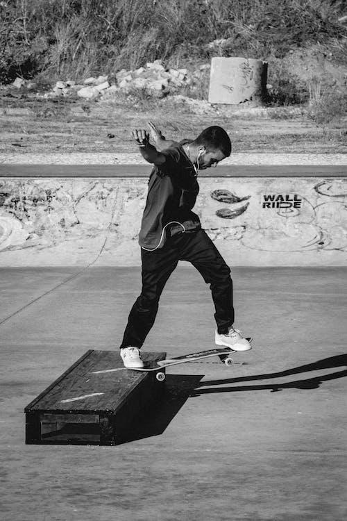 A Man Skateboarding at the Park