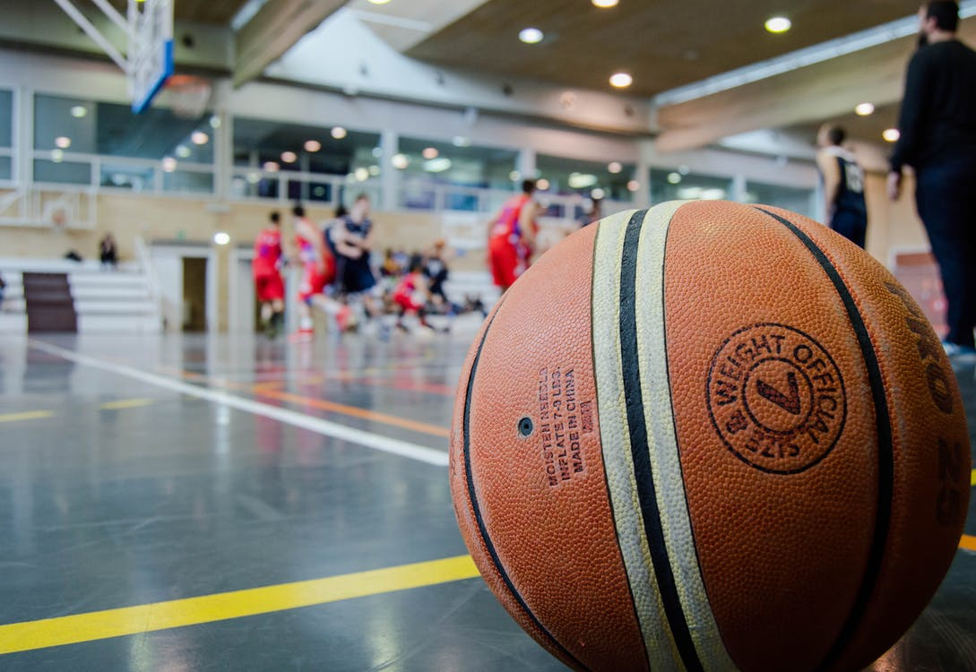 Brown Basketball on Grey Floor