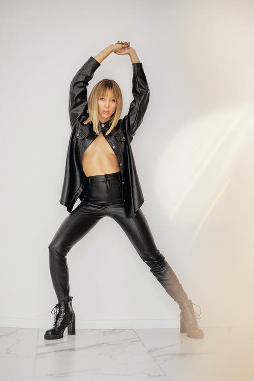 Woman in Black Leather Jacket and Black Pants