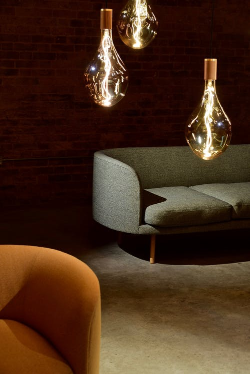Three Edison Light Bulbs Beside the Sofa