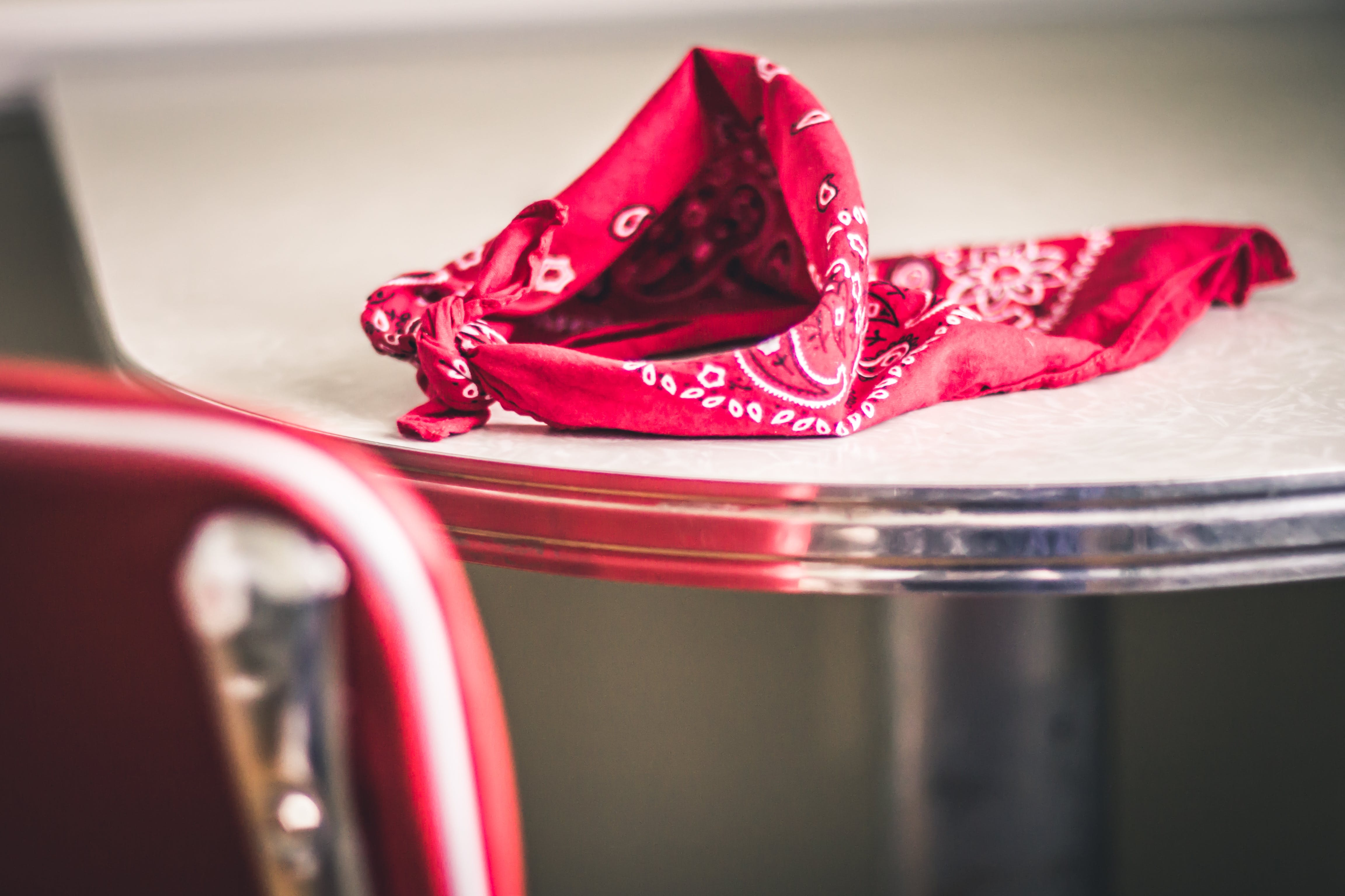 Red Paisley Handkerchief on Gray and White Table