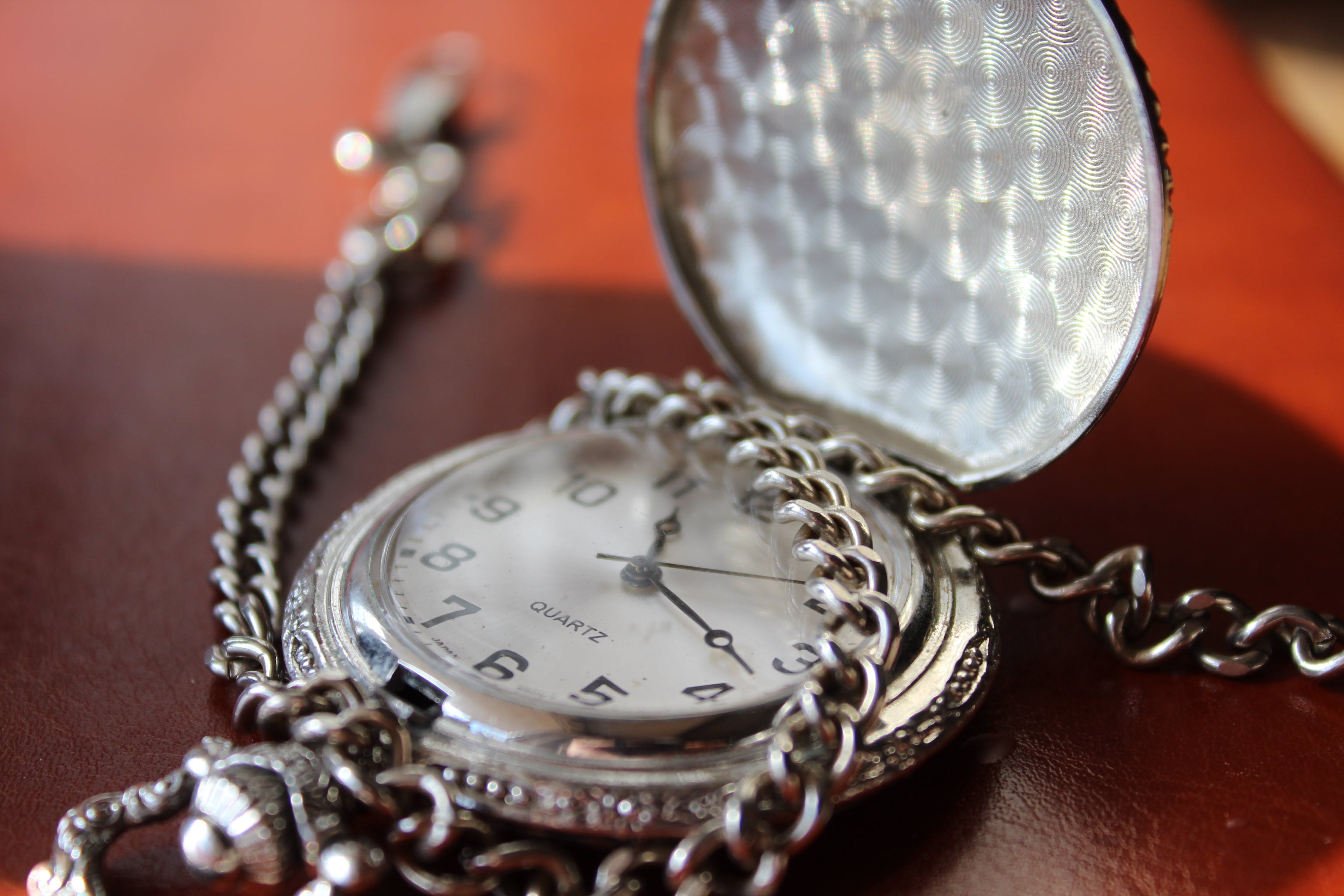 Round Silver-colored Pocket Watch