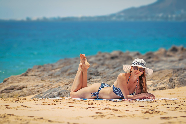 Woman in Blue Bikini on Seashore