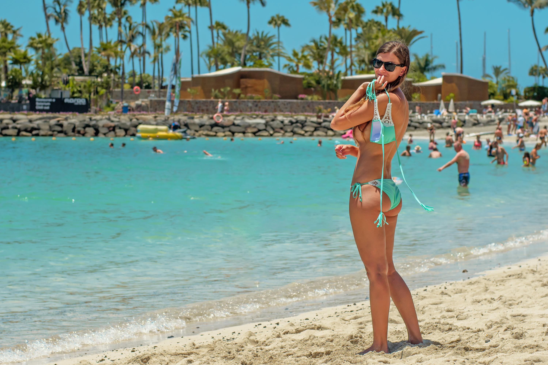 Woman Wearing Teal Bikini Standing Near Shore