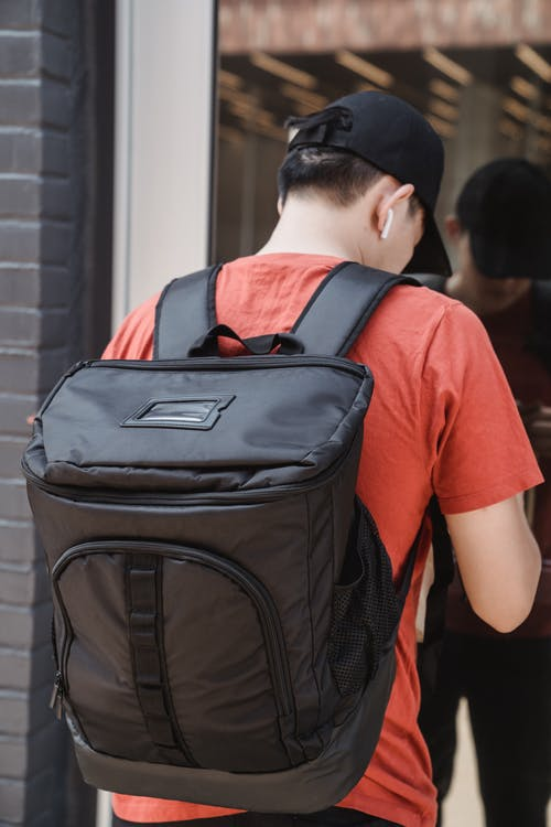 A Man Carrying a Backpack