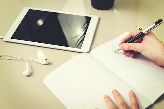 Free stock photo of hand, desk, notebook, pen