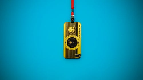 Yellow 212 Vip Camera Hanging on Blue Wall