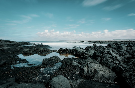 Seashore Under Blue Sky and White Clouds View