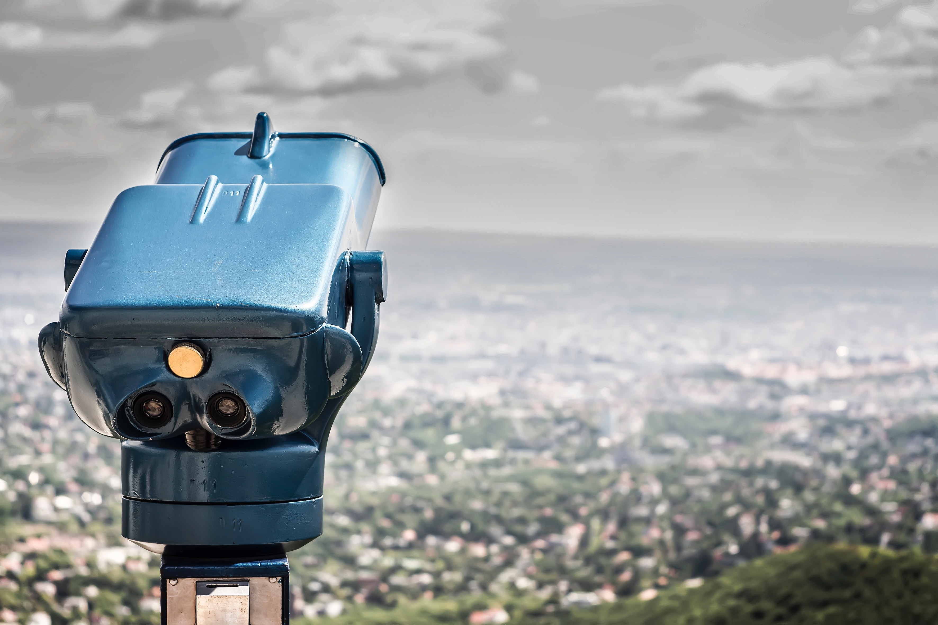 Blue Coin Operated Binocular With City View During Daytime