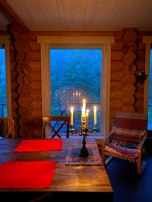 Candles on Table Near Window