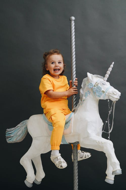 Girl in Yellow Shirt Riding White Horse Figurine